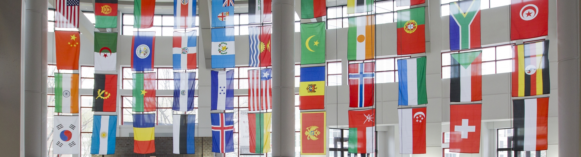 Country flags hang from the ceiling in the Temple University student center.