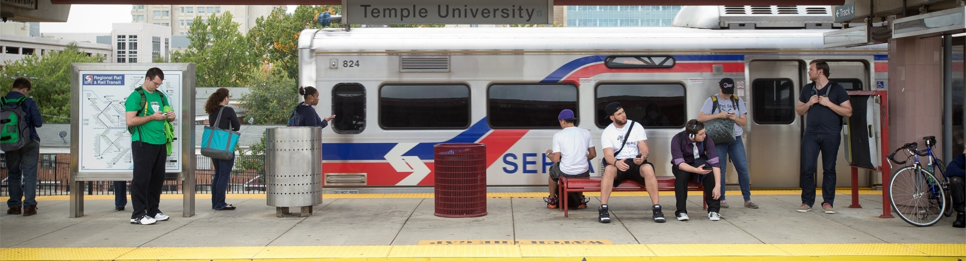 Temple University students standing on the platform at the SEPTA train station.