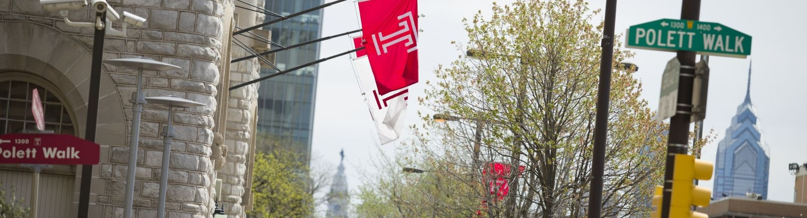 Temple University flag hanging from a building on Main Campus on Broad Street