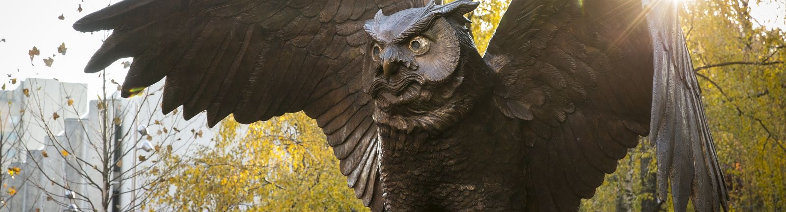 An owl sculpture in O'Connor Plaza at Temple University in the fall.