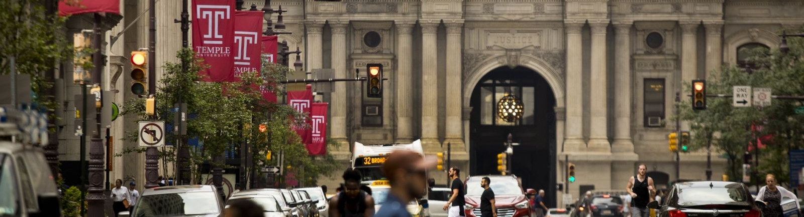 Temple University banners on Broad Street in front of Independence Hall in Philadelphia.