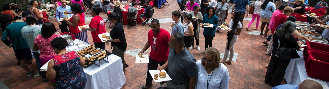 Temple University staff celebrate another successful year during a summer BBQ.