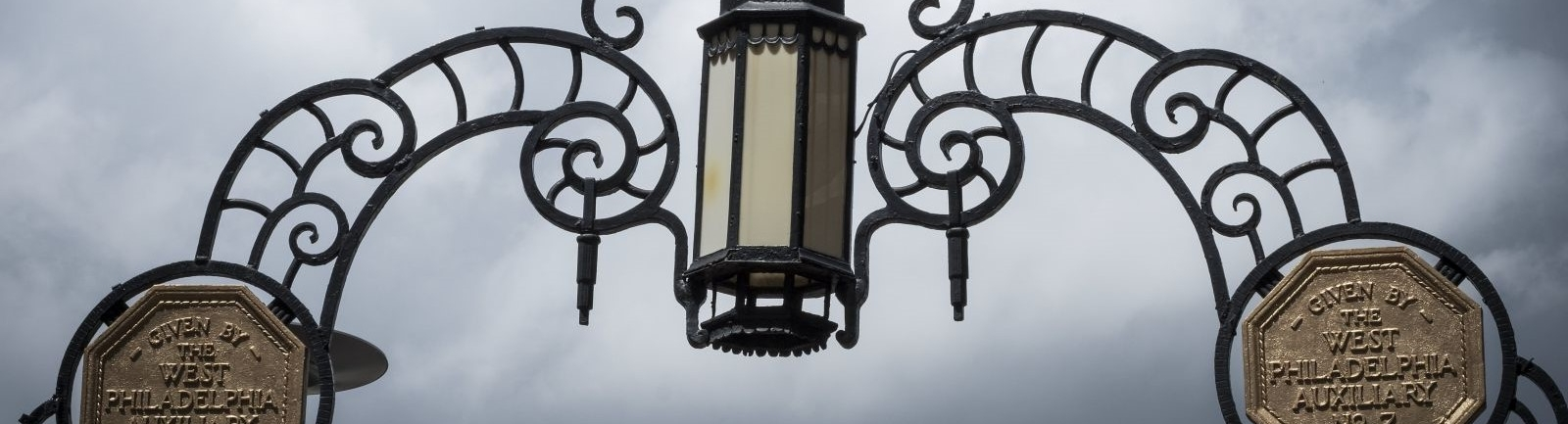 An historic iron gate and lamp on Temple University's Main Campus.