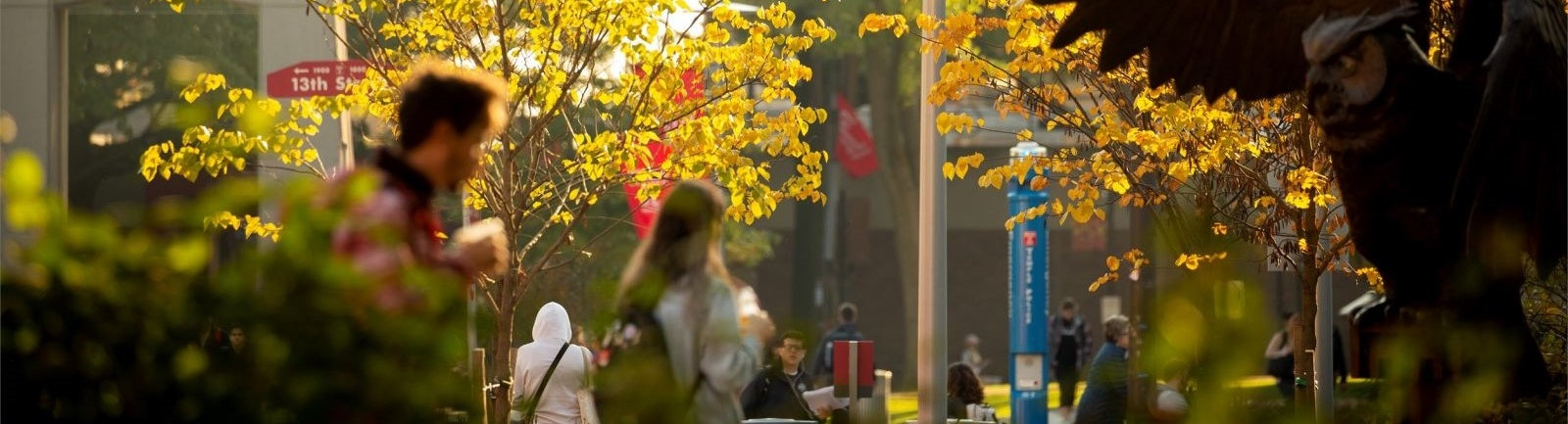 Temple University students walk across campus near 13th street during the fall.