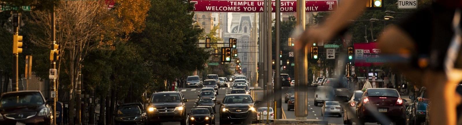 A Temple University banner flies above Broad Street in Philadelphia.