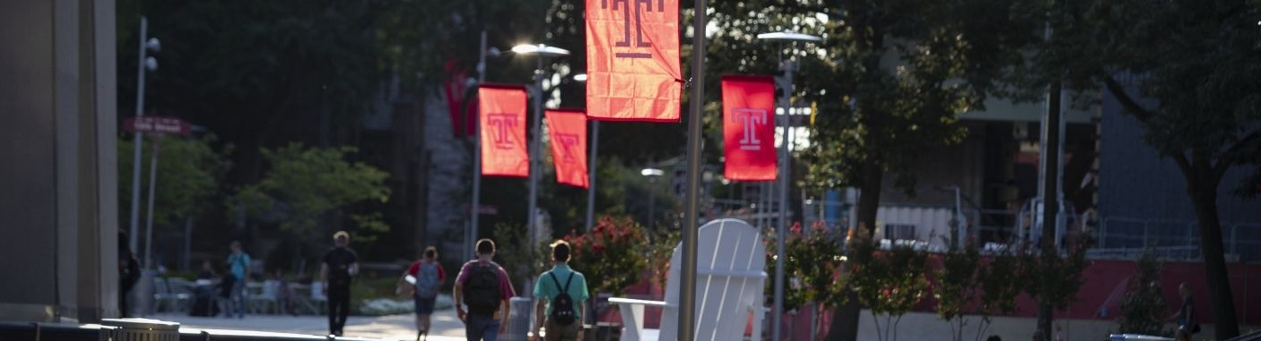 Temple University students walk through Polett Walk near the Samuel L. Paley Library.
