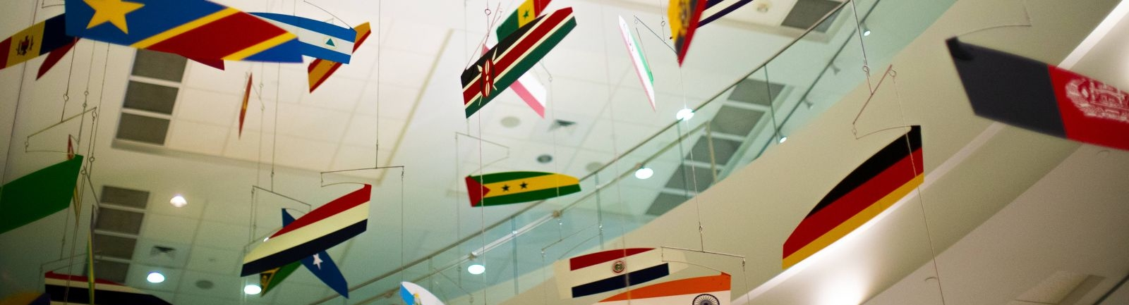 Flags adorn a ceiling in the Fox School of Business at Temple University.