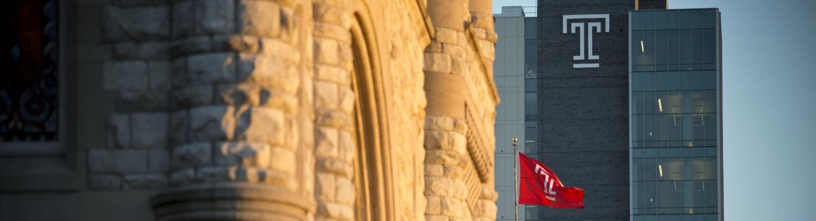 A Temple University building rises up behind a storied Philadelphia building.