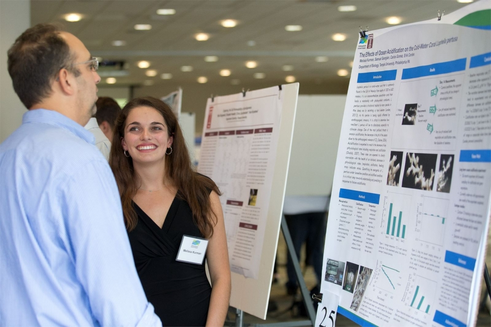 STEM student presenting her research at a poster session.