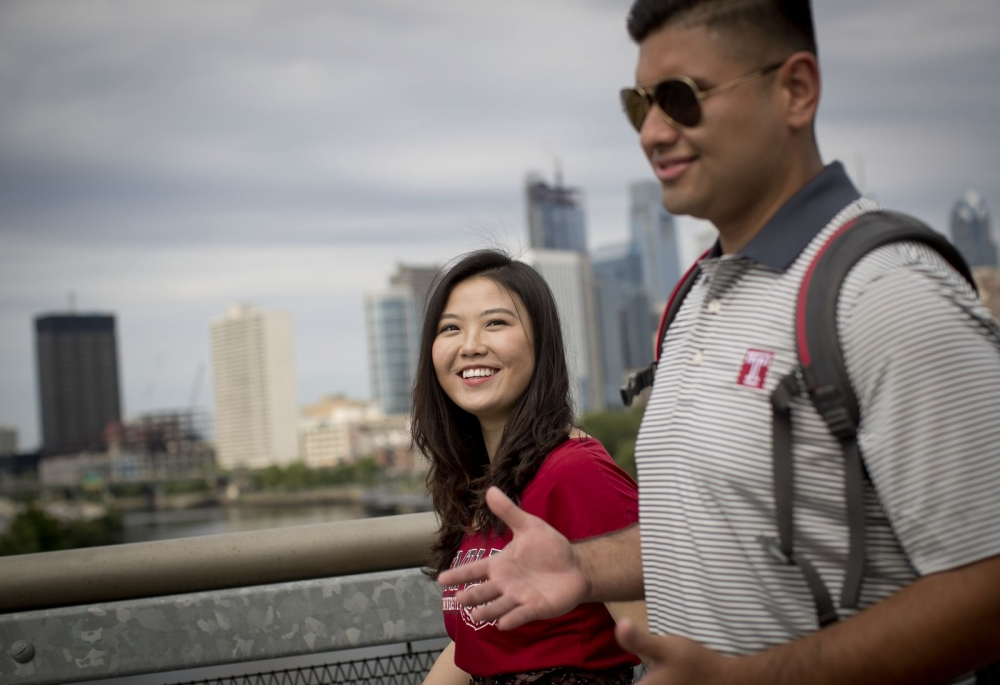 Two international Temple University students walking in Center City Philadelphia.