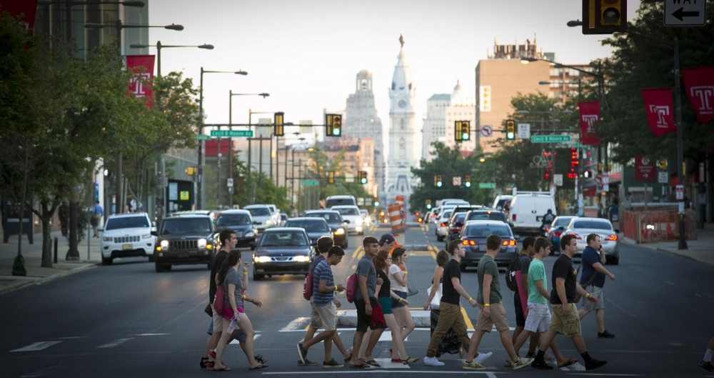 Temple University students cross Broad Street on their way to Main Campus in Philadelphia.