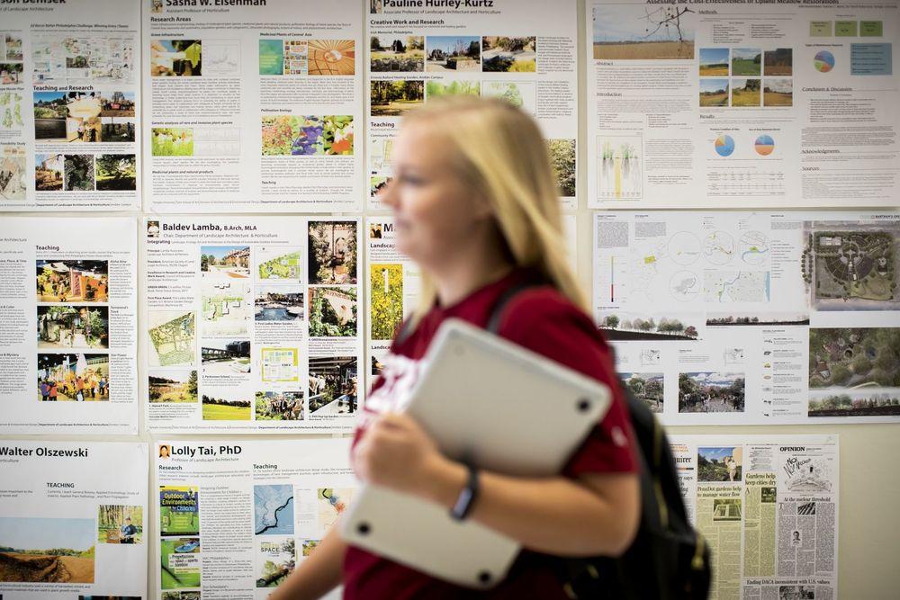 Student walks the halls at Temple University Ambler Campus.