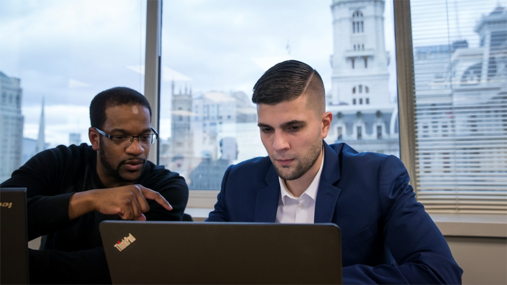 Temple University graduate students analyze information at Temple's Center City campus